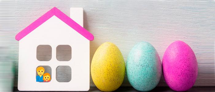 Huevos de pascua y una família en casa