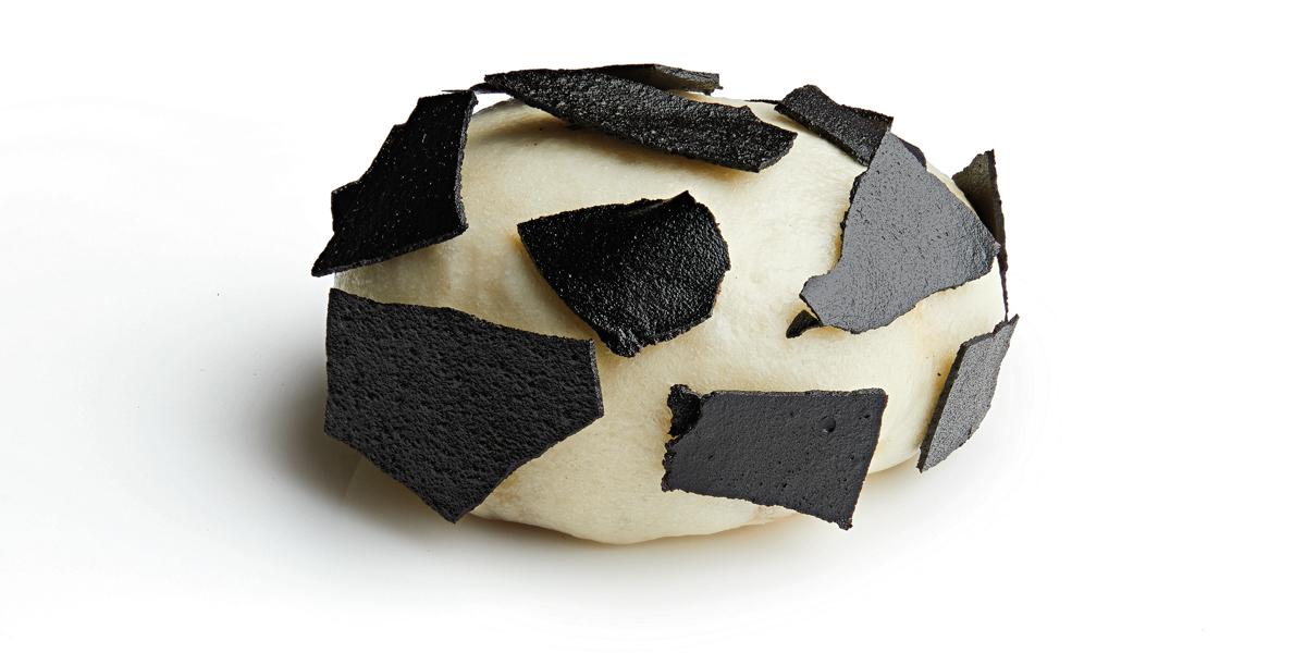 Confit de pato con ajo negro