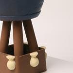 Una de las habilidades de Marc para empalmar una parte de la pieza con otra e igualarla es el uso de chocoalte embarrado, muy apreciable por ejemplo en este globo chocolatero